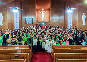 Fort Worth Bishop Michael F. Olson celebrated the 25th anniversary of Korean Martyrs Catholic Church with parishioners in 2014. (Courtesy photo/Youngha Ryu)